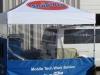 Van in portable paint spray booth