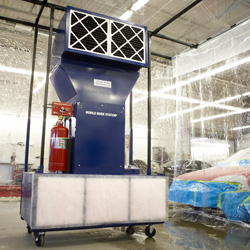 Mobile paint spray booth in auto body shop.