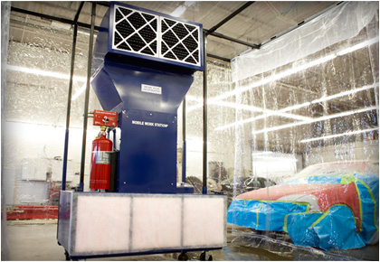 Portable automotive paint booth in body shop.